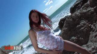 Nice young redhead Yara doing a hot striptease in the rocks photo 1